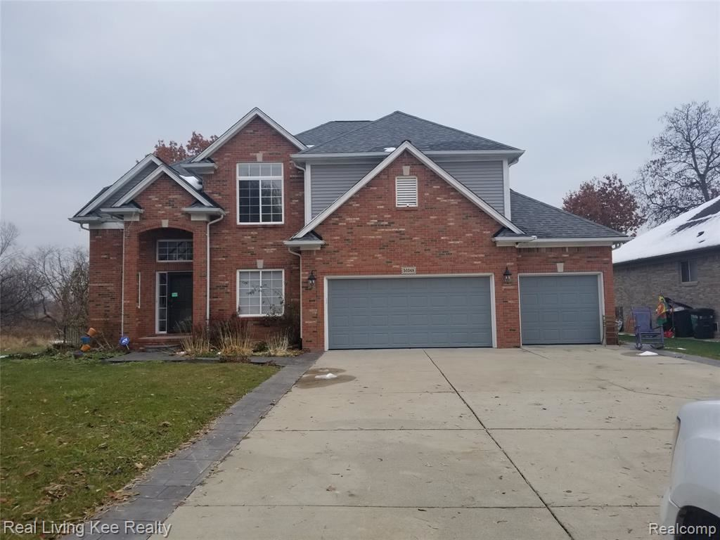 Photo of 50348 ROSE MARIE Drive, Chesterfield Township, MI 48047 (MLS # 2200002317)