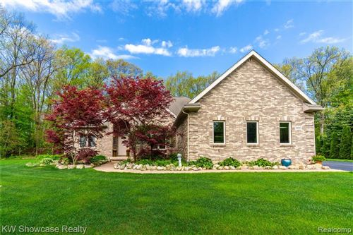 Photo of 10004 FOREST RIDGE Drive, Springfield Township, MI 48348 (MLS # 2200036339)