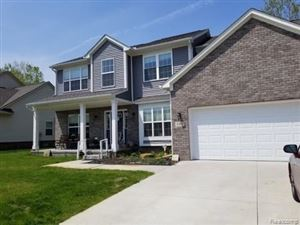 Photo of 1592 TRACE HOLLOW Drive, Commerce Township, MI 48382 (MLS # 219049364)