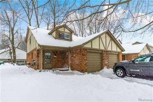 Photo of 8510 ANNSBURY Drive #D, Shelby Township, MI 48316 (MLS # 2200004377)