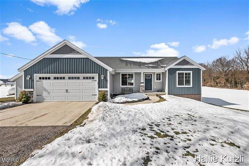 Photo of 14135 Olin Lakes Drive, Solon Township, MI 49319 (MLS # 65021006400)