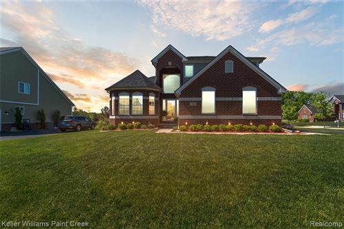 Photo of 7425 S VILLAGE Drive, Independence Township, MI 48346 (MLS # 2200038435)