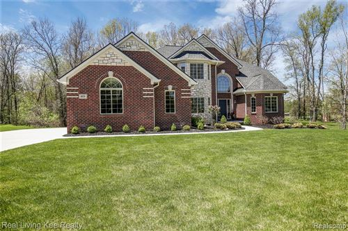 Photo of 8939 HUNTERS CREEK Drive, Independence Township, MI 48348 (MLS # 2200036461)