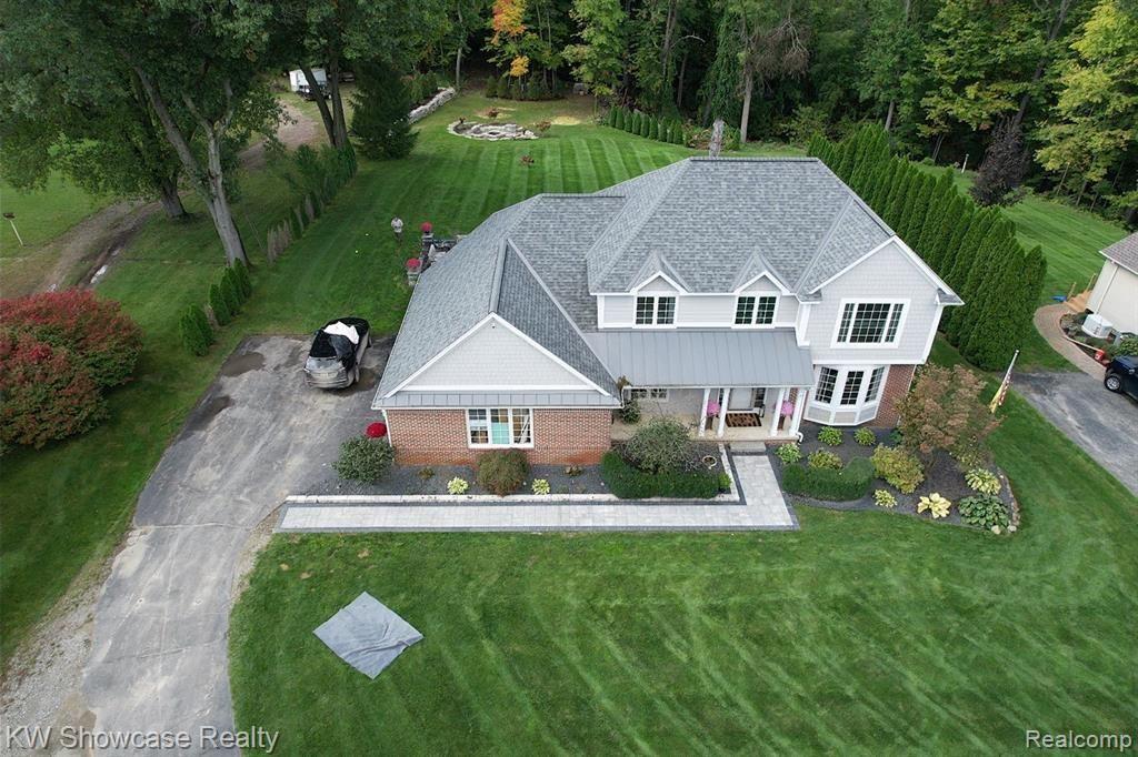 Photo of 1076 BIRD Road, Groveland Township, MI 48462 (MLS # 2210086538)