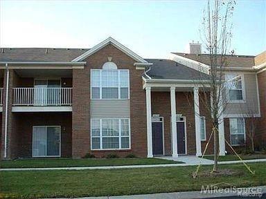 Photo of 16304 GRANDVIEW Drive #88, Macomb Township, MI 48044 (MLS # 2200102542)
