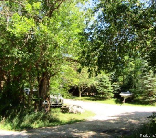 Photo of 7850 HICKORY RIDGE Road, Rose Township, MI 48442 (MLS # 2200075554)