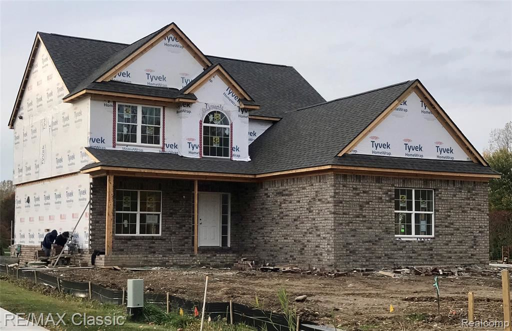 Photo of 21557 HASENCLEVER Drive, Lyon Township, MI 48178 (MLS # 2200086578)