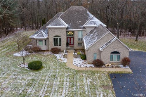 Photo of 9305 THORNHILL Drive, Independence Township, MI 48348 (MLS # 219111677)
