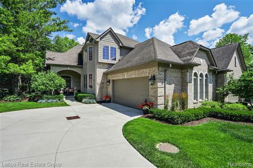 Photo of 6542 ENCLAVE Drive, Independence Township, MI 48348 (MLS # 2200049692)