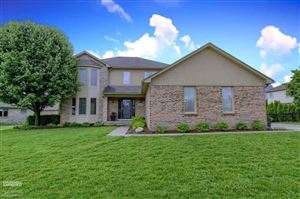 Photo of 15848 HARBISON DR., MACOMB Township, MI 48042 (MLS # 58031383698)
