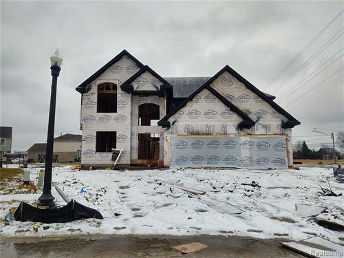 Photo of 21834 HIGHLANDS Drive, Macomb Township, MI 48044 (MLS # 2200085703)
