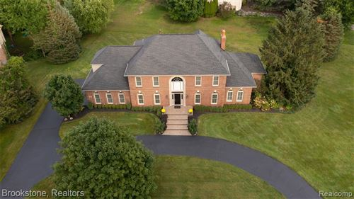 Photo of 8684 HUNTERS CREEK, Independence Township, MI 48348 (MLS # 2210072735)