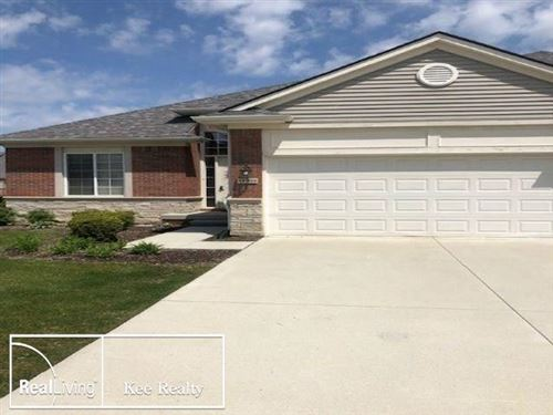 Photo of 14939 VILLAGE PARK CIR #84, SHELBY Township, MI 48315 (MLS # 58050011800)