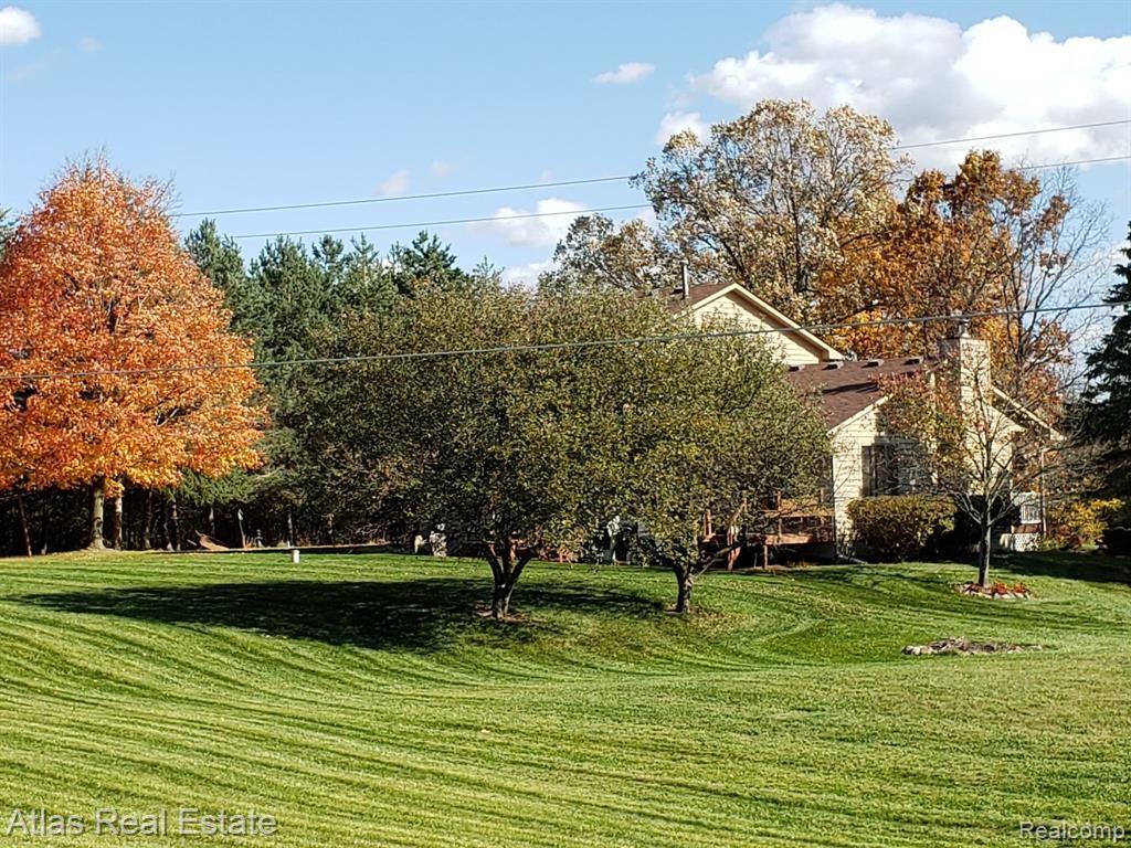 Photo of 711 BARRON Road, Groveland Township, MI 48462 (MLS # 2210003850)