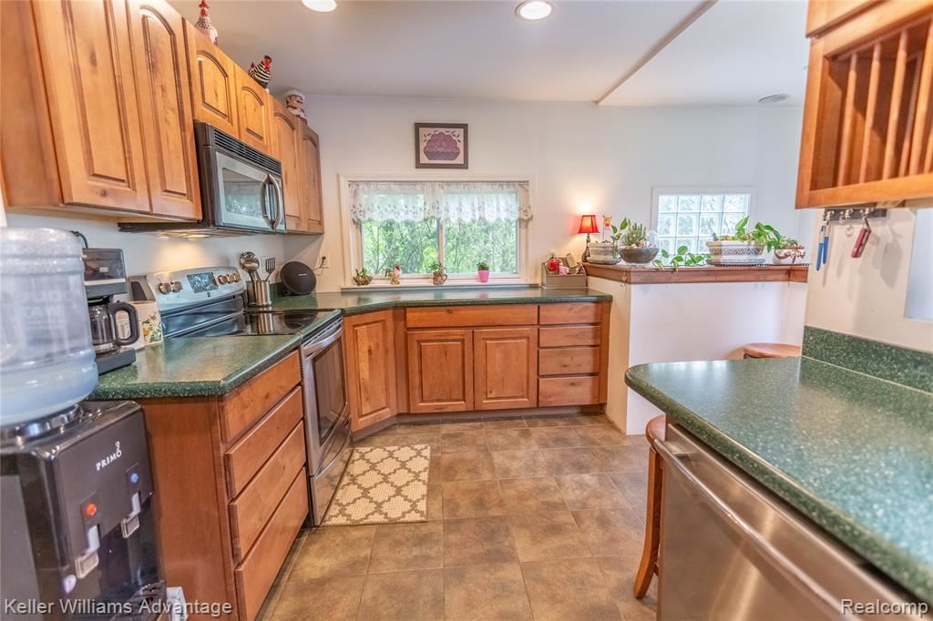 Photo of 2565 BRISBANE Street, Wolverine Lake Village, MI 48390 (MLS # 2210032897)
