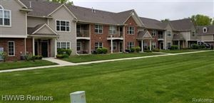 Photo of 49094 W WOODS Drive #989, Shelby Township, MI 48317 (MLS # 219048966)