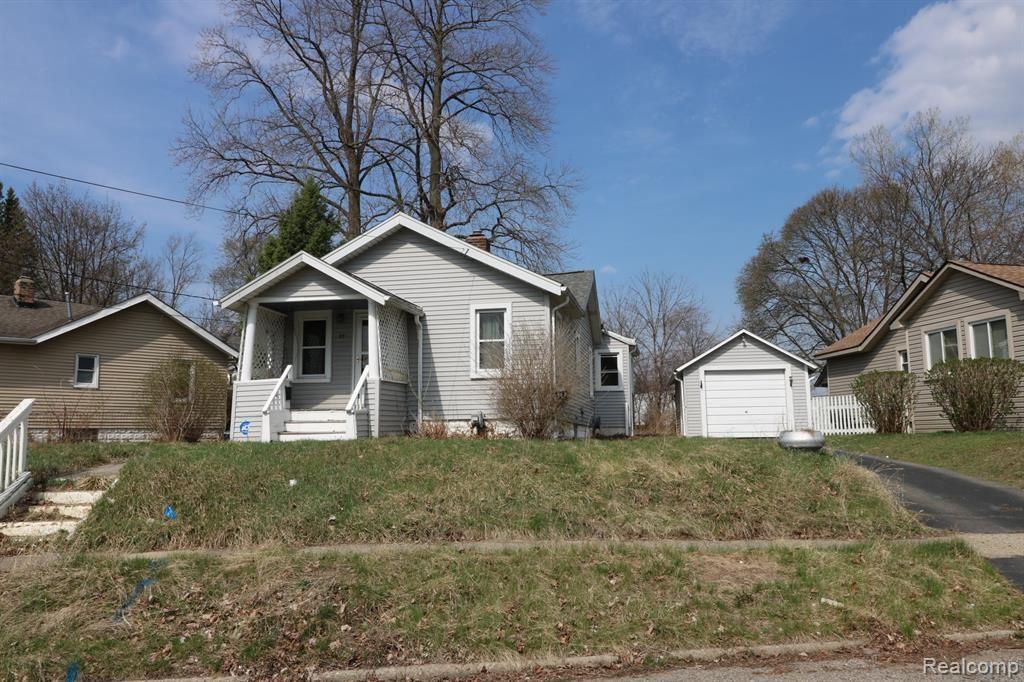 Photo of 93 OMAR Street, Pontiac, MI 48342 (MLS # 2210031971)