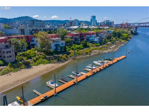 Photo of 720 NW NAITO PKWY #D1, Portland, OR 97209 (MLS # 21632010)