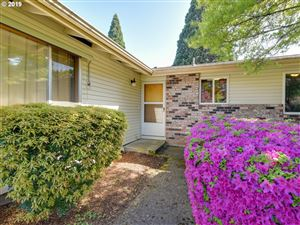Photo of 14960 SE CARUTHERS CT, Portland, OR 97233 (MLS # 19002019)
