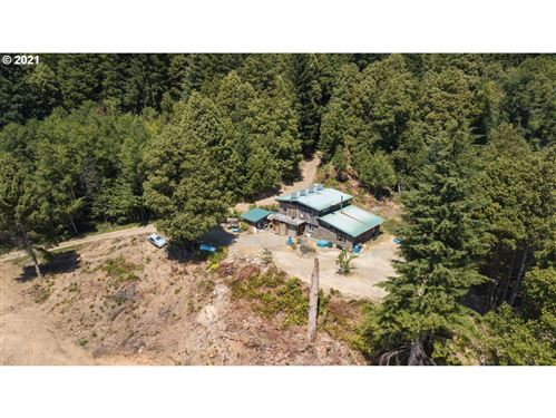 Photo of 97800 EUCHRE CREEK RD, Gold Beach, OR 97444 (MLS # 21069192)