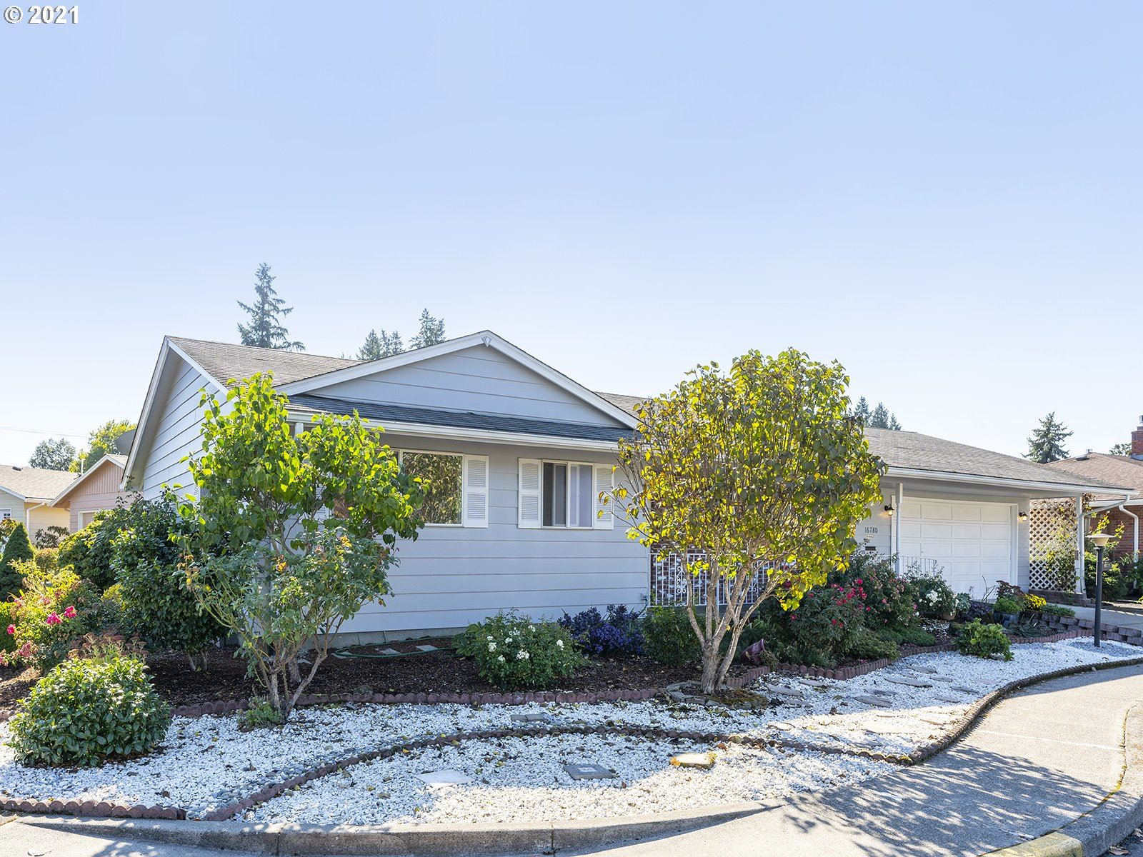 Photo of 16780 SW ROYALTY PKWY, King City, OR 97224 (MLS # 21672229)