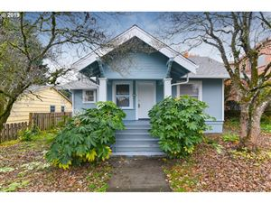 Photo of 7706 SE YAMHILL ST, Portland, OR 97215 (MLS # 19057339)