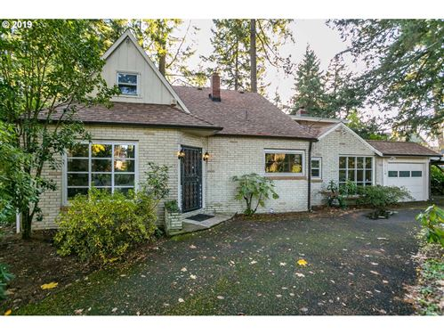 Photo of 13130 SE LINCOLN ST, Portland, OR 97233 (MLS # 19467348)