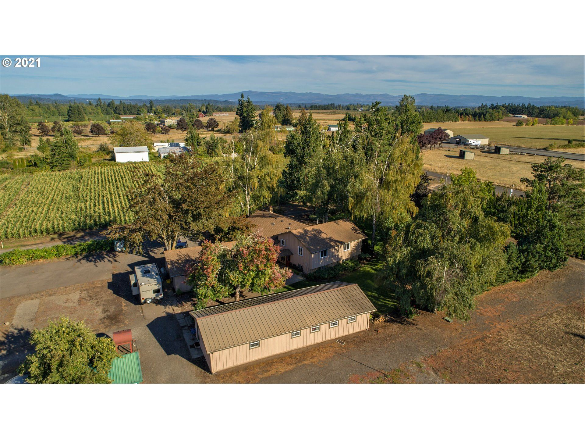 Photo of 10107 S KRAXBERGER RD, Canby, OR 97013 (MLS # 21624398)