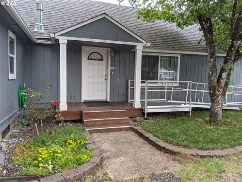 Photo of 13519 SE HARRISON CT, Portland, OR 97233 (MLS # 20063462)