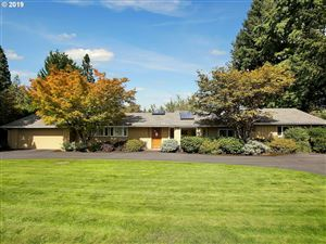 Photo of 8625 SW WOODSIDE DR, Portland, OR 97225 (MLS # 19608481)