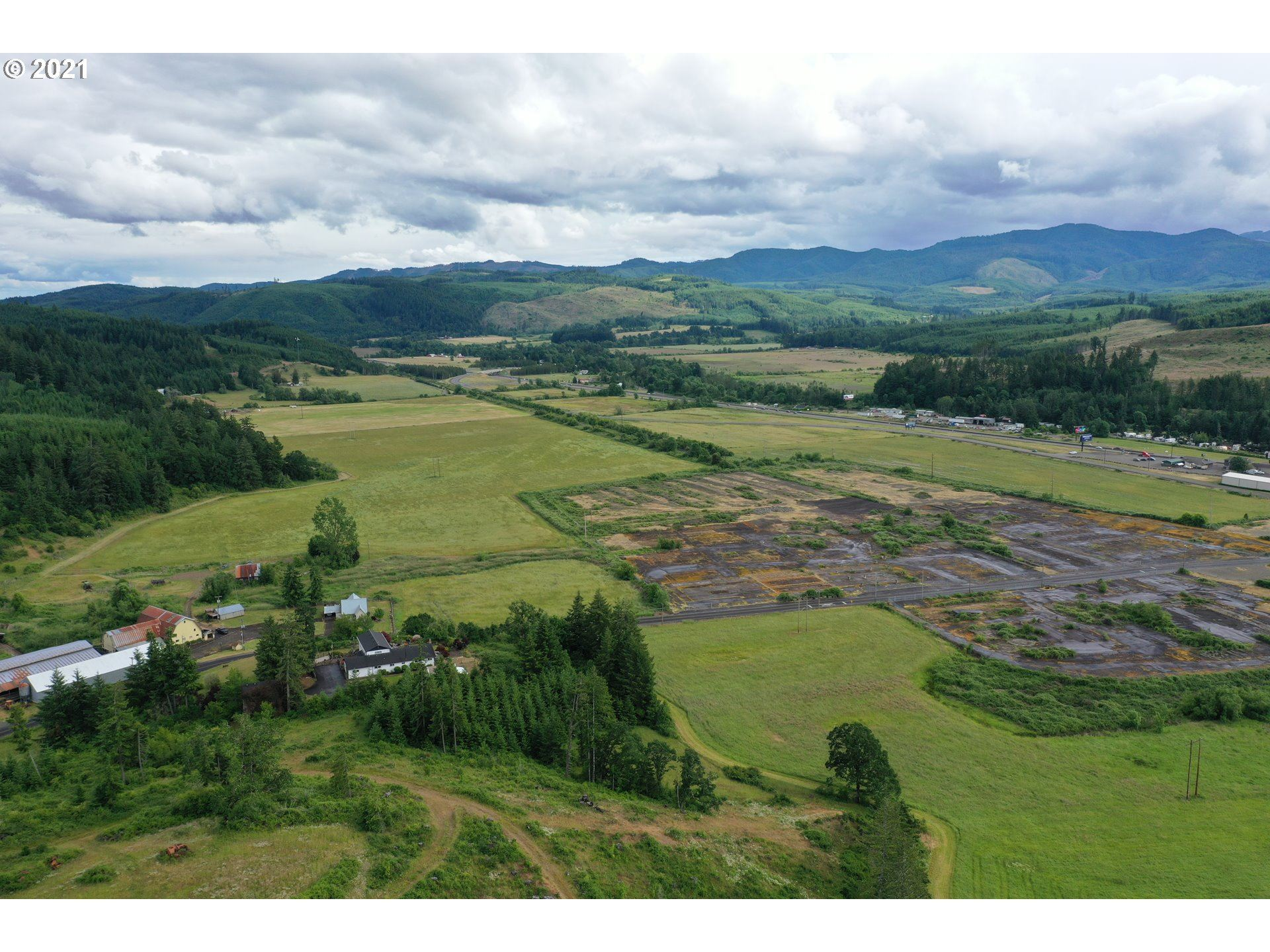 Photo of 9040 FORT HILL RD, Willamina, OR 97396 (MLS # 21472504)