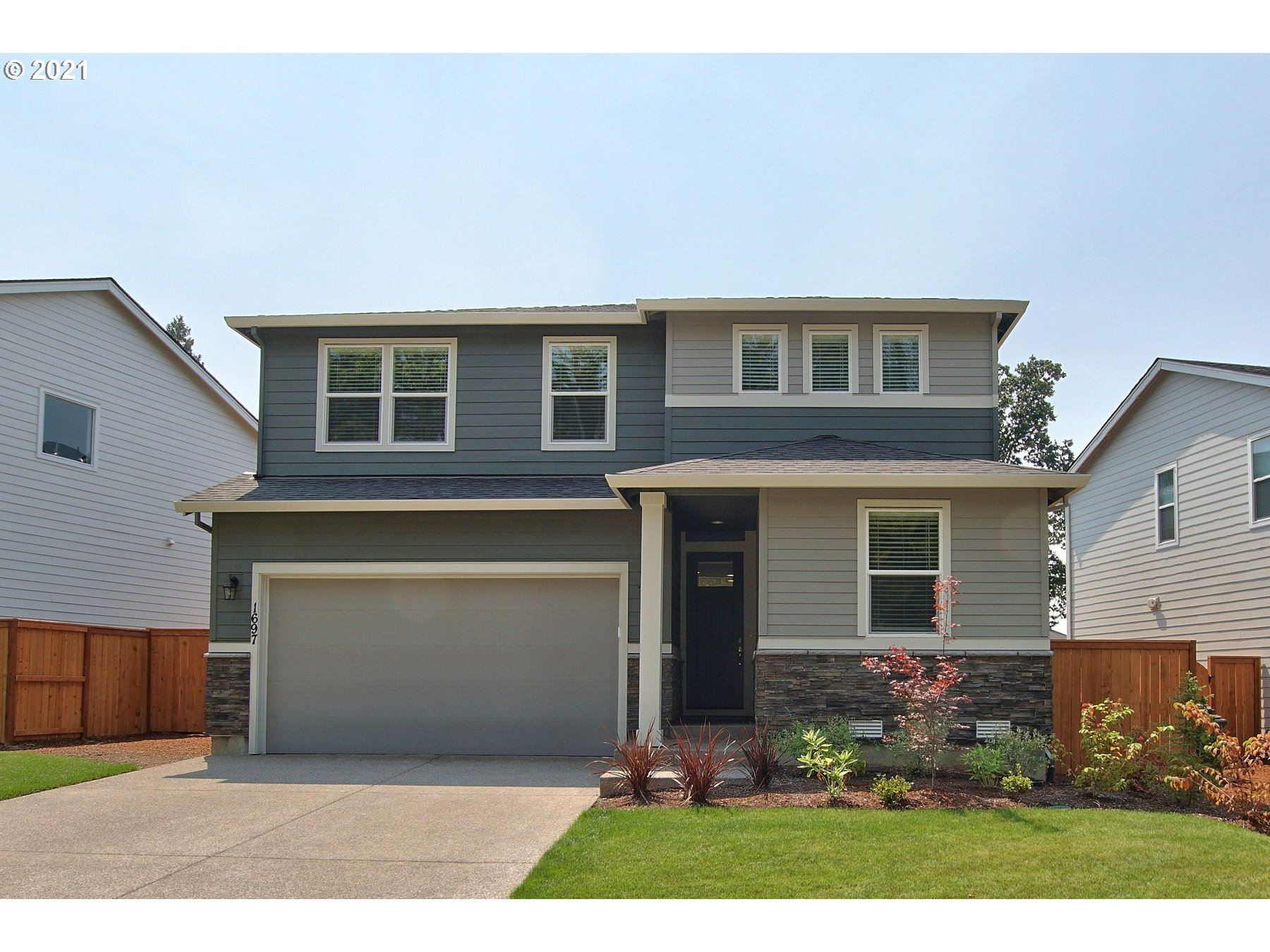 Photo of 1697 N SYCAMORE ST, Canby, OR 97013 (MLS # 21526515)