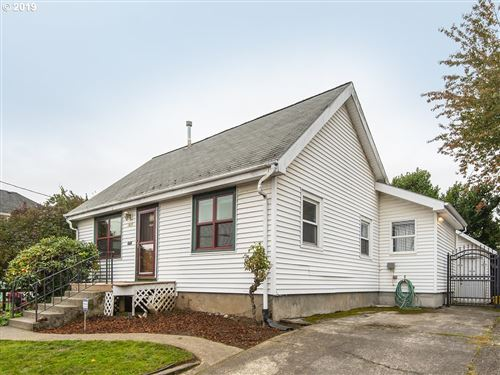 Photo of 7625 N VAN HOUTEN AVE, Portland, OR 97203 (MLS # 19603553)