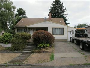 Photo of 11421 SE SALMON ST, Portland, OR 97216 (MLS # 19194663)