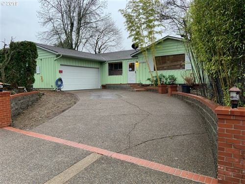 Photo of 10930 SE CHERRY BLOSSOM DR, Portland, OR 97216 (MLS # 19276753)
