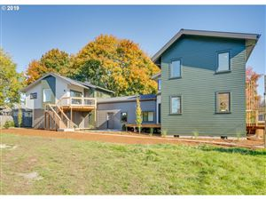 Photo of 8697 SE WASHINGTON ST, Portland, OR 97216 (MLS # 19187768)