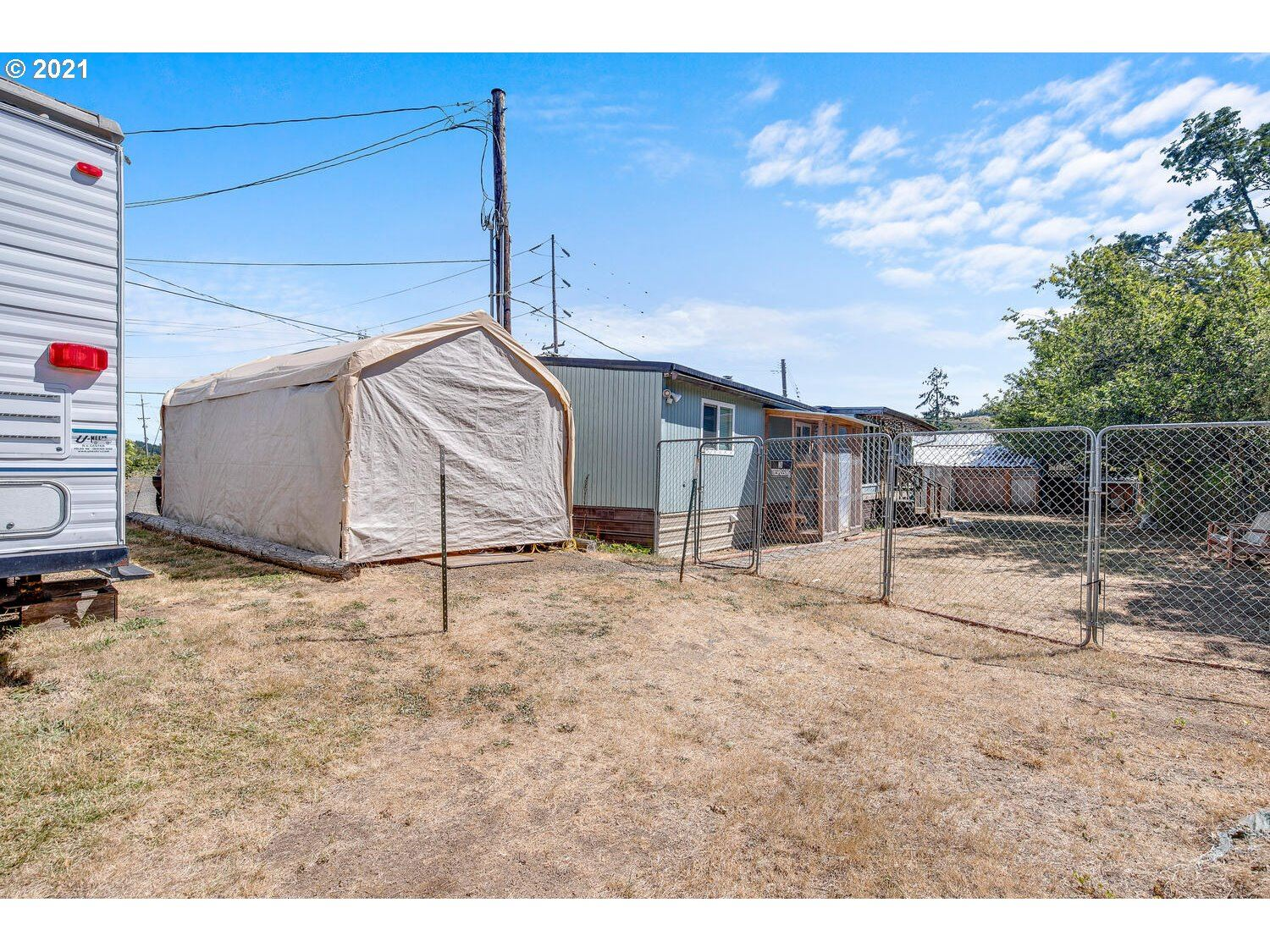 Photo of 8855 FORT HILL RD WILLAMI, Willamina, OR 97396 (MLS # 21484768)