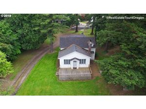 Photo of 650 NW DIVISION ST, Gresham, OR 97030 (MLS # 19467889)