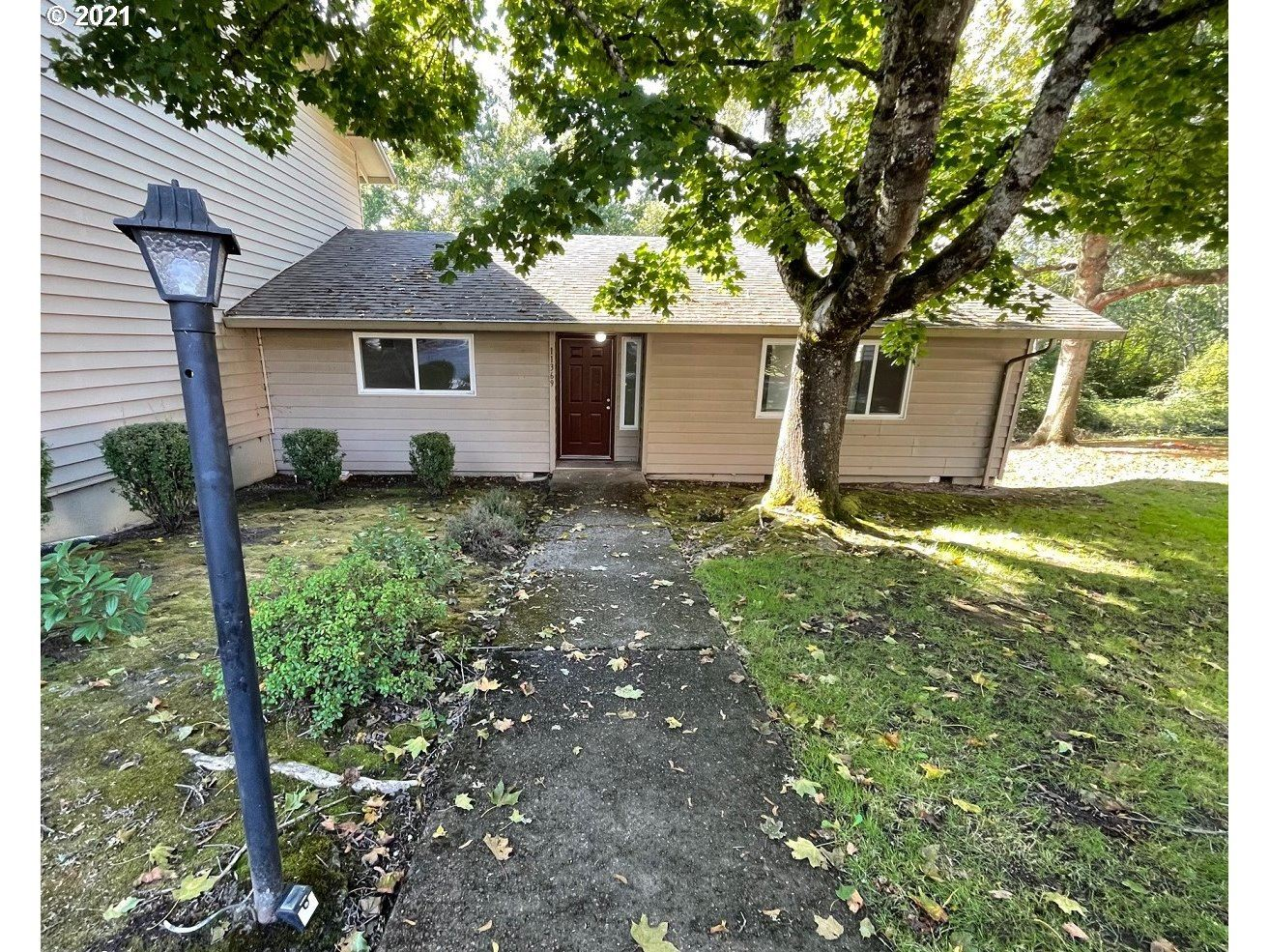Photo of 11369 SW SPRINGWOOD DR, Tigard, OR 97223 (MLS # 21123921)