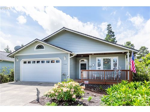 Photo of 1948 SEABROOK LN, Florence, OR 97439 (MLS # 21209939)