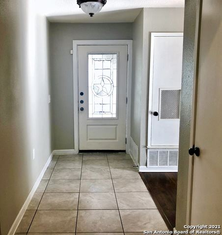 Photo of 7833 LAZY FOREST ST, Live Oak, TX 78233 (MLS # 1560031)