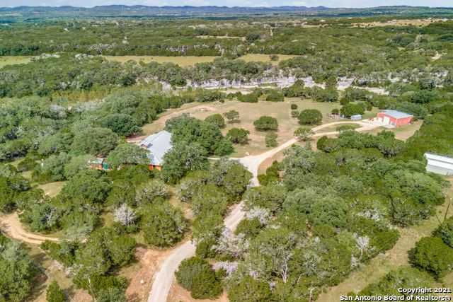 Photo of 502 GREEN VALLEY DR, Pipe Creek, TX 78063 (MLS # 1554686)