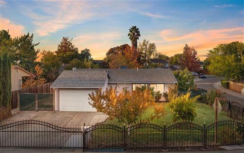 Photo of 5721 Tupelo Drive, Sacramento, CA 95842 (MLS # 221137070)