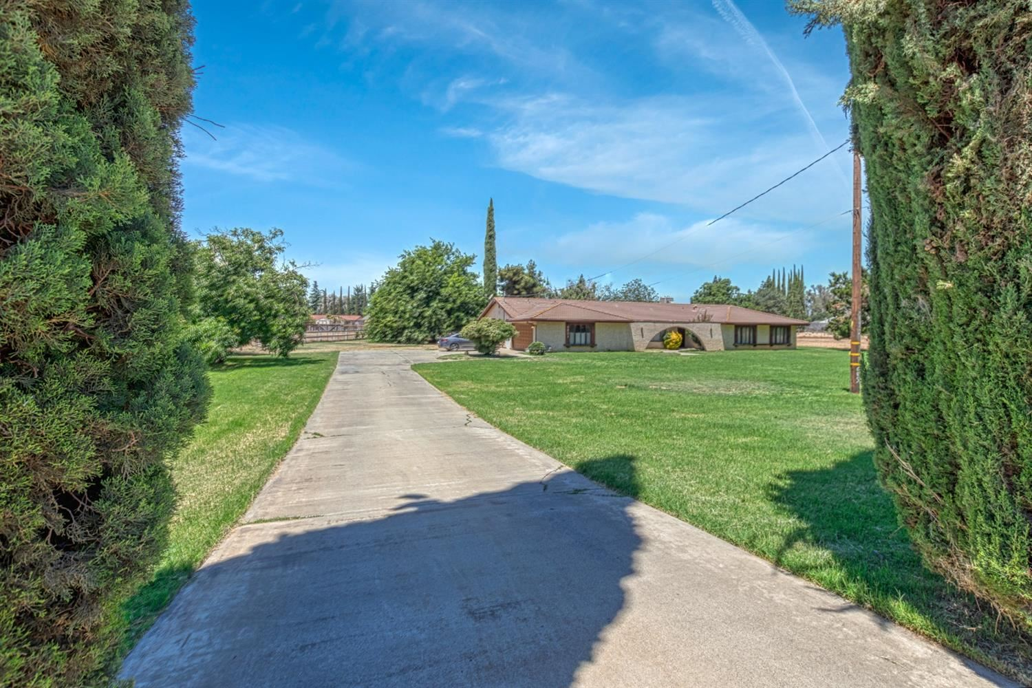 Photo of 2821 Buhach Road, Atwater, CA 95301 (MLS # 221071389)
