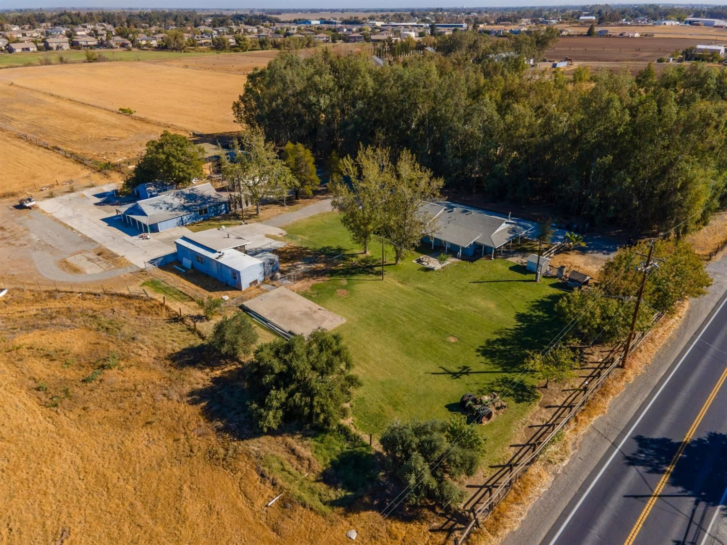Photo of 33680 State Highway 16, Woodland, CA 95695 (MLS # 221132606)