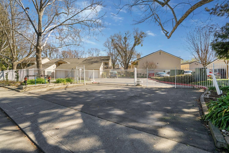 Photo of 5905 Gloria Drive #5, Sacramento, CA 95822 (MLS # 221010827)