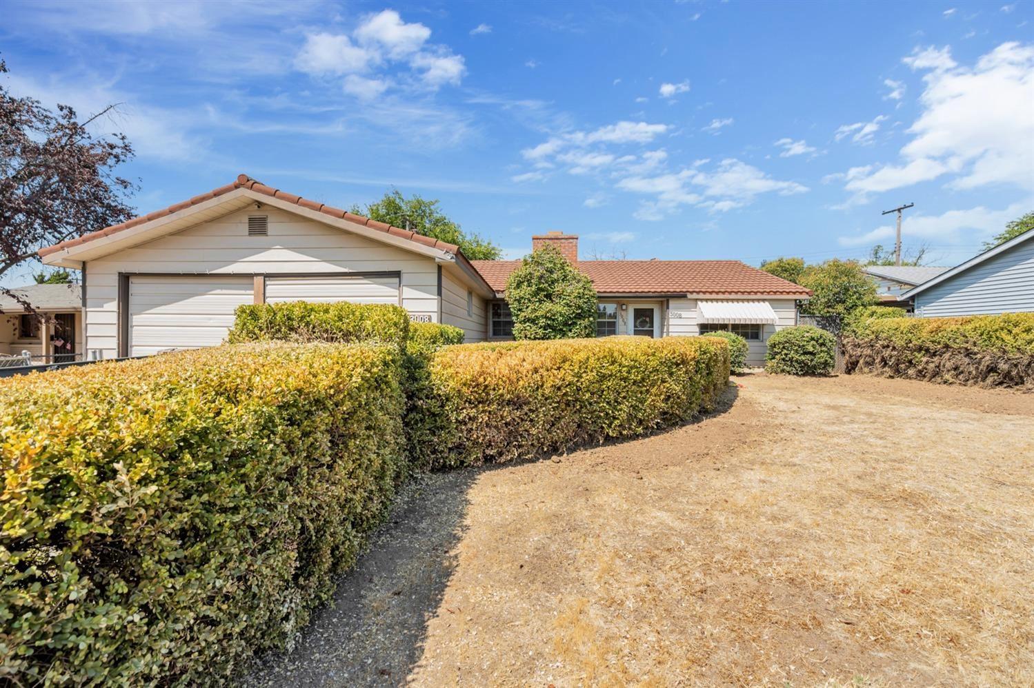 Photo of 3008 Mills Park Drive, Rancho Cordova, CA 95670 (MLS # 221114838)