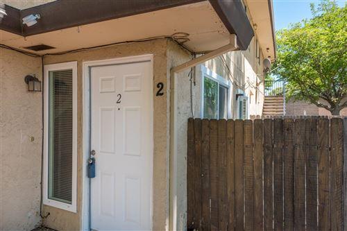 Photo of 4718 GREENHOLME Drive #2, Sacramento, CA 95842 (MLS # 221093952)