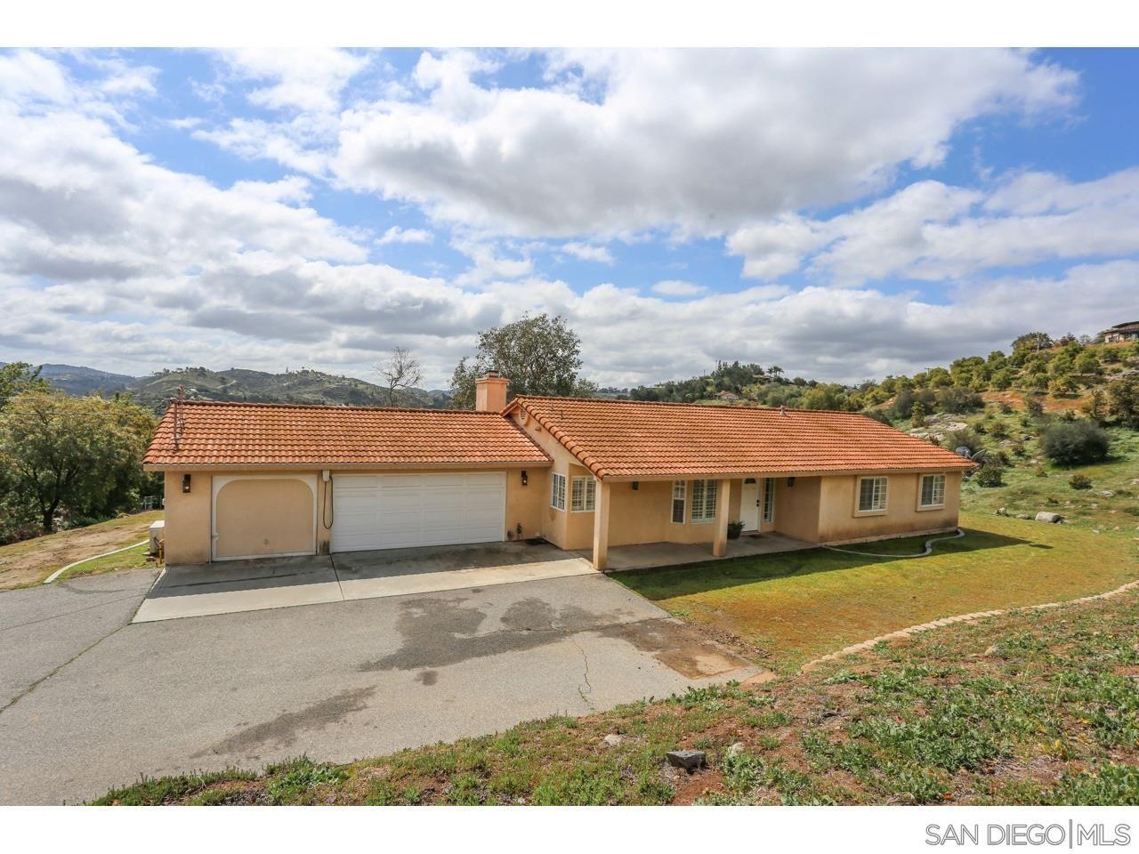 Photo of 12852 Anthony Lane, Valley Center, CA 92082 (MLS # 210008042)