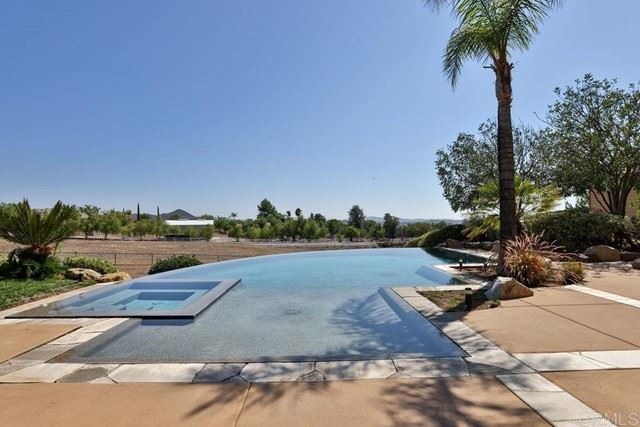 Photo of 30585 Crescent Moon Dr., Valley Center, CA 92082 (MLS # PTP2106082)